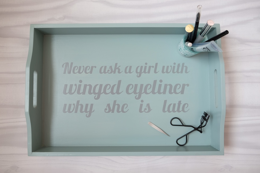 Stencil with the phrase 'Never ask a girl with winged eyeliner why she is late' onto an upcycled tray by Nadine Muir. Made using free font called Stencil Silhouette UK and cut using my Cameo.